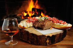 Tasty steak on a background of fire Stock Images