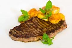 Tasty Steak with deep fried Potato Royalty Free Stock Photos