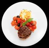Tasty steak isolated on black Stock Image