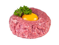 Tasty Steak tartare. Classic steak tartare over white. Ingredients: Raw beef meat salt pepper egg garlic chili herb decoration and Royalty Free Stock Photography