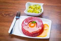 Tasty steak tartare on the plate Royalty Free Stock Photography