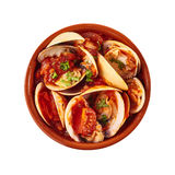 Tasty steamed Venus shell clams with a spicy sauce Stock Image
