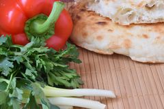 Tasty stllife with red pepper, greenery and pita. Red pepper, greenery and pita Stock Photo
