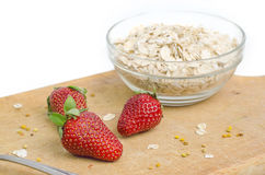 Tasty Strawberries In Front Of Bowl With Oat Meal Royalty Free Stock Photo