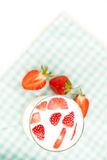 Tasty strawberries and a glass of fresh milk as healthy background Royalty Free Stock Photos