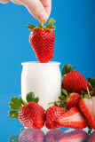 Tasty strawberries and yogurt. Fresh and tasty strawberries and yogurt Royalty Free Stock Photos