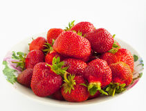Tasty strawberry. On a plate on a gray background Stock Images