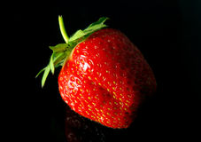 Tasty strawberry on black Stock Photo