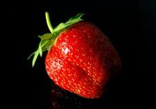 Tasty strawberry on black Stock Photo