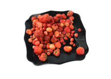 Tasty strawberry in black plate Stock Photography