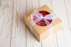 Strawberry cream cake and mousse homemade bakery in box. Tasty strawberry cream cake homemade bakery in box on white wooden background Royalty Free Stock Photos