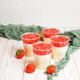 Strawberry dessert cheesecake trifle or panna cota. Tasty strawberry dessert cheesecake trifle in glass on white wooden table Royalty Free Stock Photography