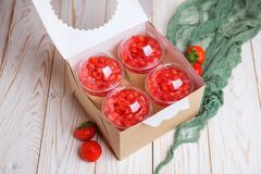 Tasty strawberry dessert cheesecake trifle. In glass on wooden table Stock Photography