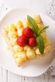 Tasty strawberry millefeuille with custard closeup. Vertical top Stock Images