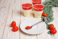 Tasty strawberry mousse pudding or panna cota. In glass on wooden table Royalty Free Stock Photo