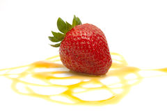 Tasty strawberry on a swirl of a vanilla Royalty Free Stock Photos