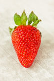 Tasty strawberry on wooden textured table Stock Photography