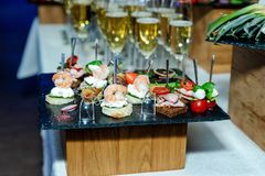 Tasty and stylish snack for guests on skewers stock photography