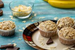 Tasty sugar muffins with almond, walnuts and chocolate stock images