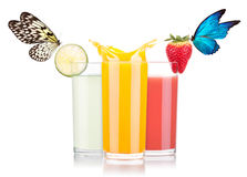 Tasty summer fruit drinks beautiful butterfly. Tasty summer fruit drinks in glass with splash and beautiful butterfly isolated on a white background Stock Photo