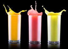 Tasty summer fruit drinks in glass with splash Royalty Free Stock Image