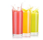 Tasty summer fruit drinks in glass with splash Royalty Free Stock Images
