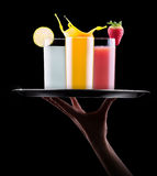 Tasty summer fruit drinks with splash on tray Stock Photos