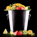 Tasty summer fruits in bucket Royalty Free Stock Images