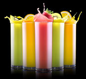 Tasty summer fruits with juice in glass Royalty Free Stock Image