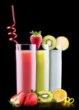 Tasty summer fruits with juice in glass Stock Images