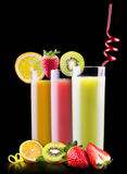 Tasty summer fruits with juice in glass Stock Photos
