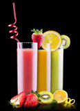 Tasty summer fruits with juice in glass Stock Photography