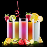 Tasty summer fruits with juice in glass Stock Photo
