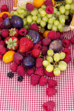 Tasty summer fruits on a red tablecloth Royalty Free Stock Photos