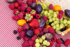 Tasty summer fruits on a red tablecloth Stock Photo