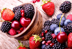 Tasty summer fruits on a wooden table Royalty Free Stock Photos
