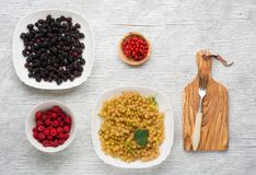 Tasty summer fruits on a wooden table. raspberries Royalty Free Stock Images
