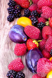 Tasty summer fruits on a wooden table Royalty Free Stock Images