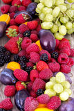 Tasty summer fruits on a wooden table Stock Images