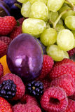 Tasty summer fruits on a wooden table Royalty Free Stock Photography