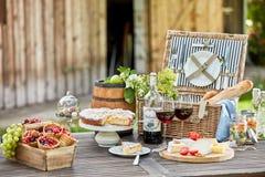 Tasty summer picnic al fresco on a garden table royalty free stock photo