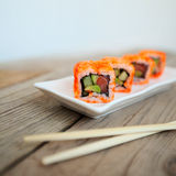Tasty sushi with chopsticks. Japan traditional seafood Stock Photos