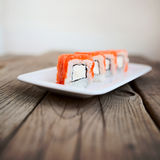 Tasty sushi with chopsticks. Japan traditional seafood Stock Image