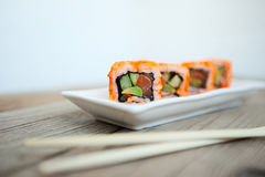 Tasty sushi with chopsticks. Japan traditional seafood Royalty Free Stock Photos