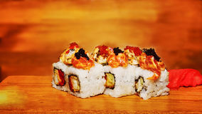 Tasty sushi garnished and decorated with red and white caviar Royalty Free Stock Photos