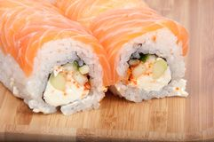 Tasty sushi roll on the wooden board. Background royalty free stock photography