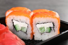 Tasty sushi rolls in box, closeup. Food delivery service royalty free stock photos
