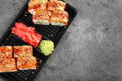 Tasty sushi rolls in box on grey table, top view with space for text. Food delivery stock images