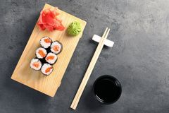 Tasty sushi rolls on served grey table, top view. Food delivery stock image