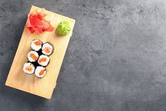 Tasty sushi rolls served on grey table, top view with space for text. Food delivery stock image